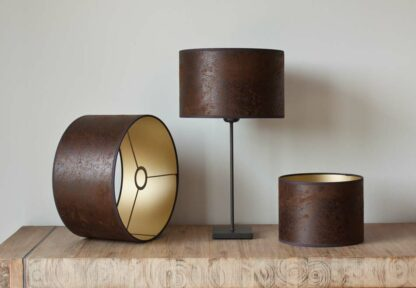 Cilinder lampshades in leather, color light brown with golden backing